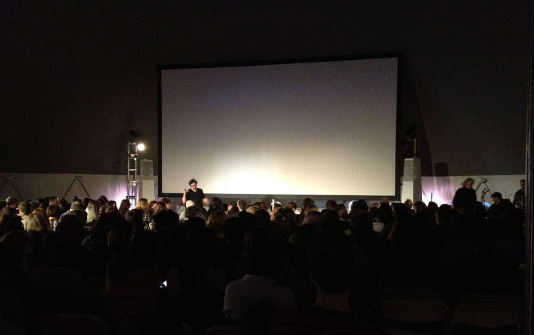 theatre installation showing screen and attendees